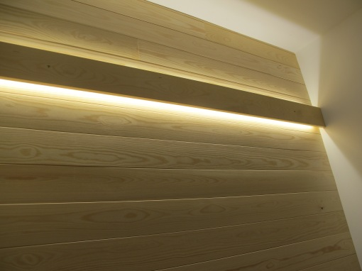 Wooden panel with led strips. Use full spectrum leds, 5500 K, it shows also the wood color original, not yellow like here.